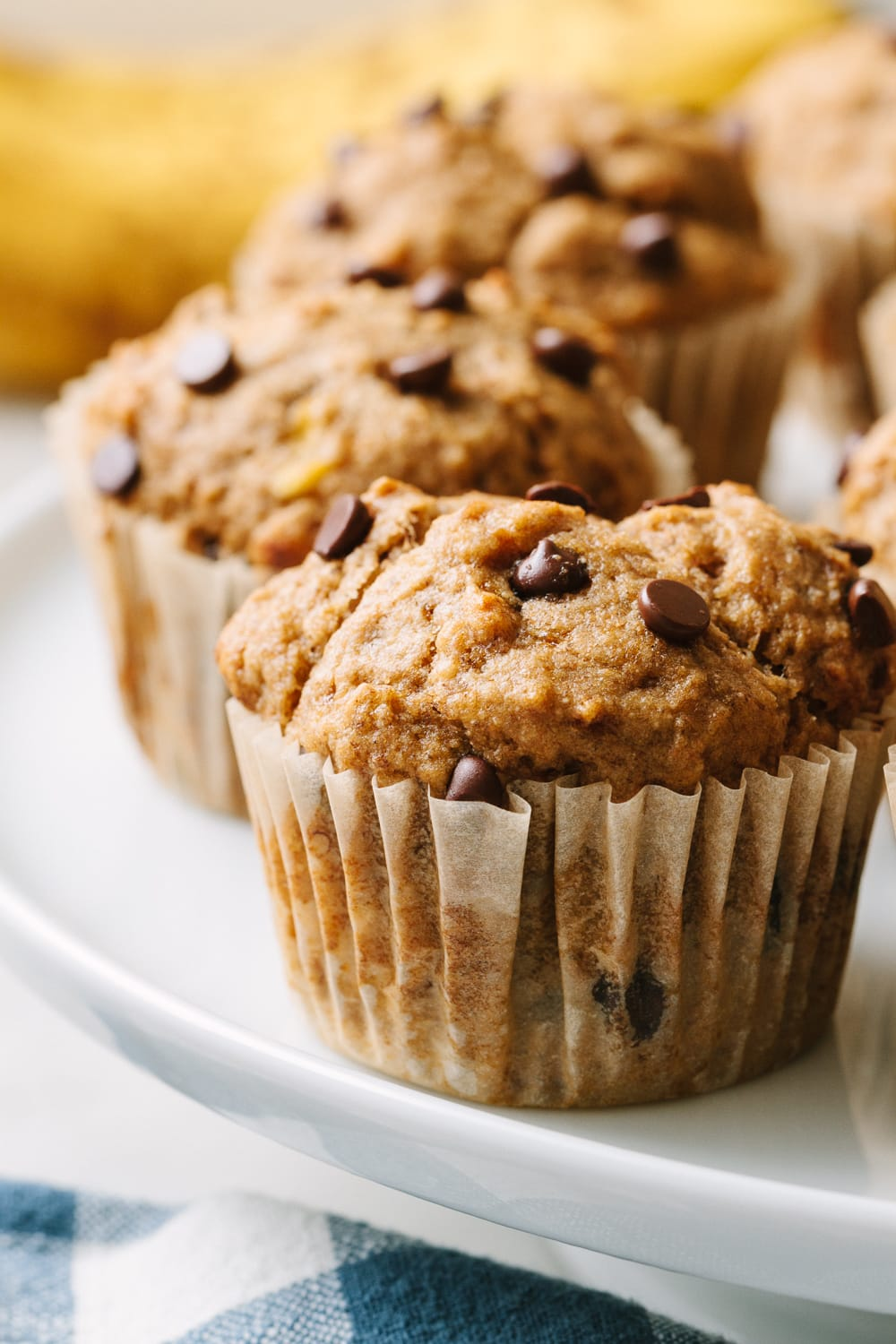 side angle view of a group of healthy vegan banana bread muffins.
