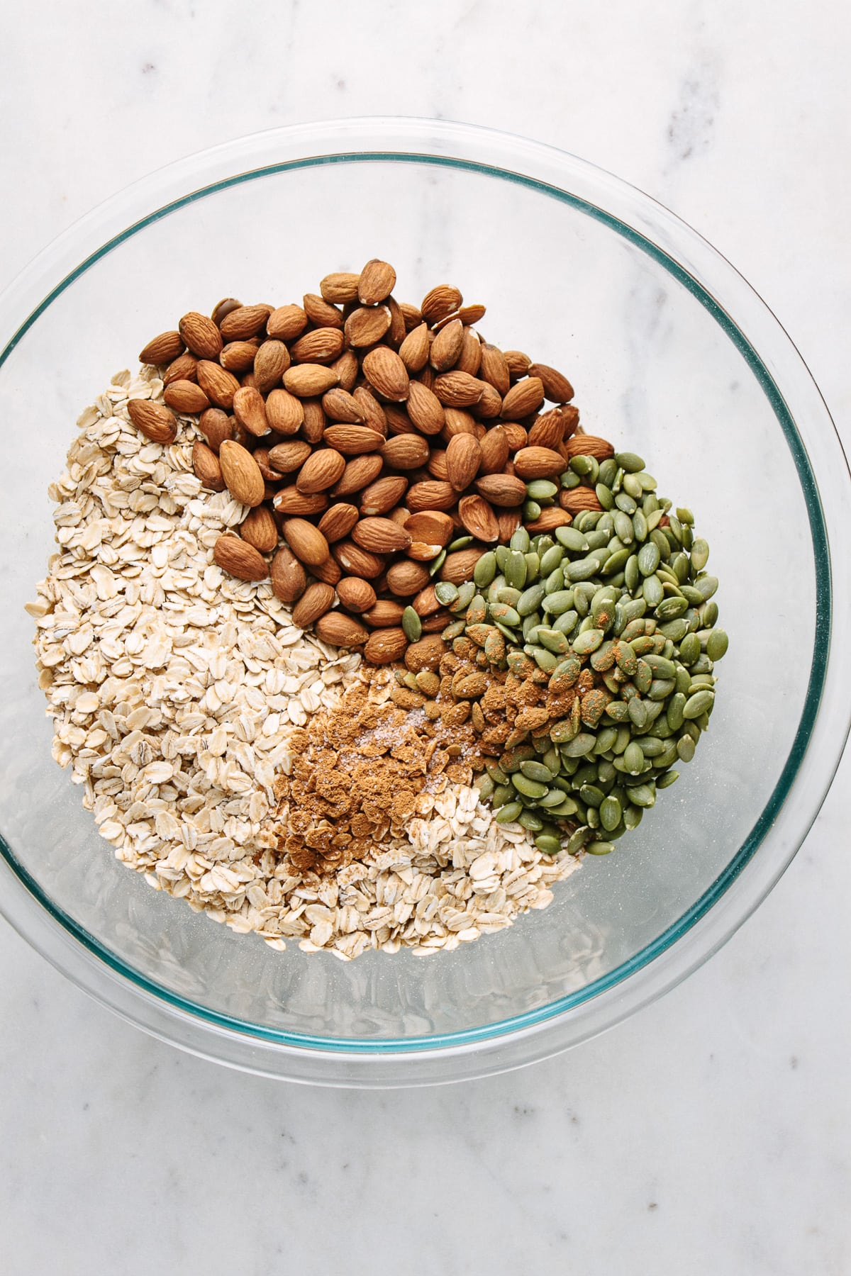 top down view of dry ingredients add to bowl for making peanut butter granola snack cluster granola.