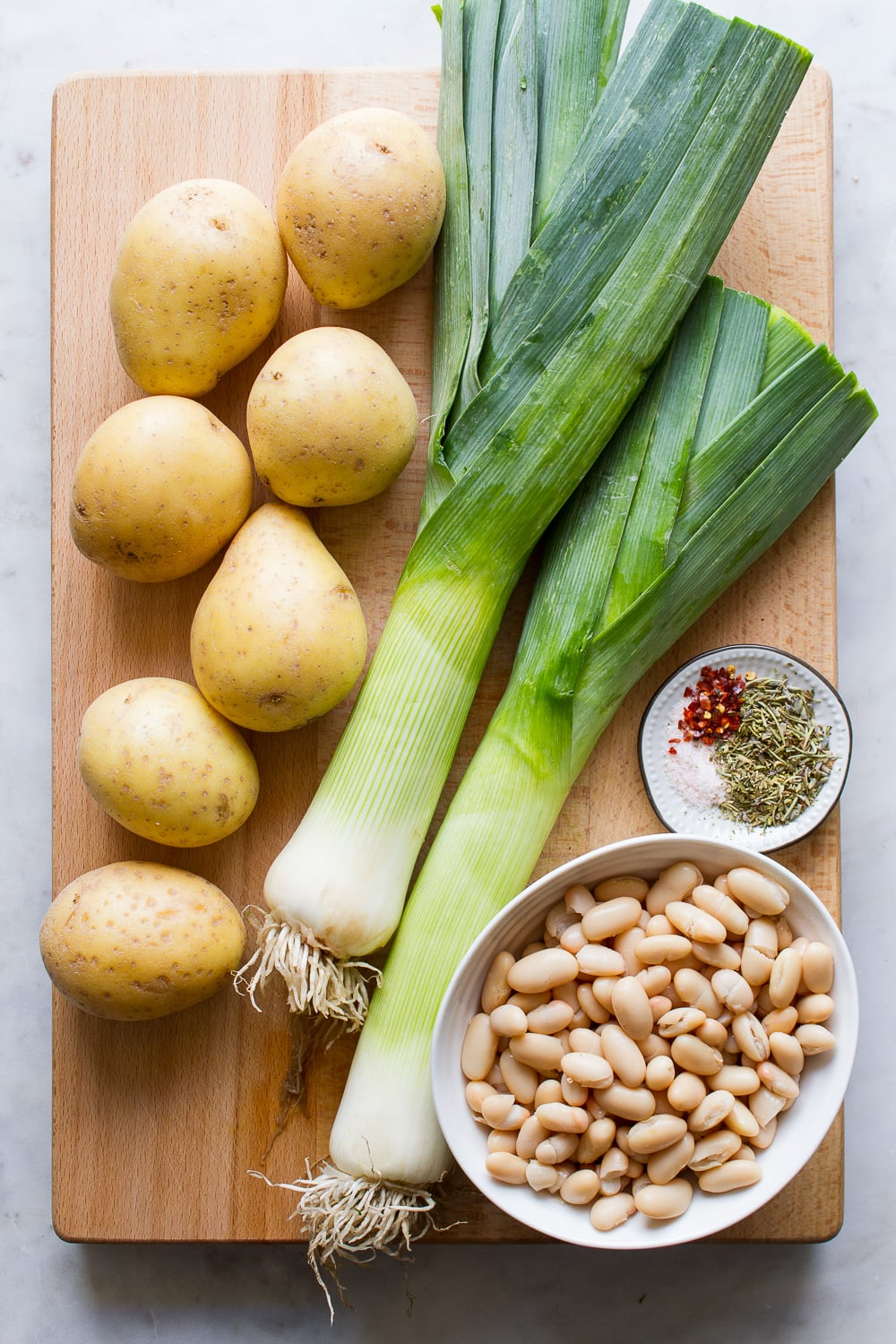 top down view of the ingredients used to make potato, leek and white bean soup.
