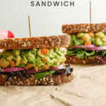 mashed chickpea and avocado sandwich sliced in half