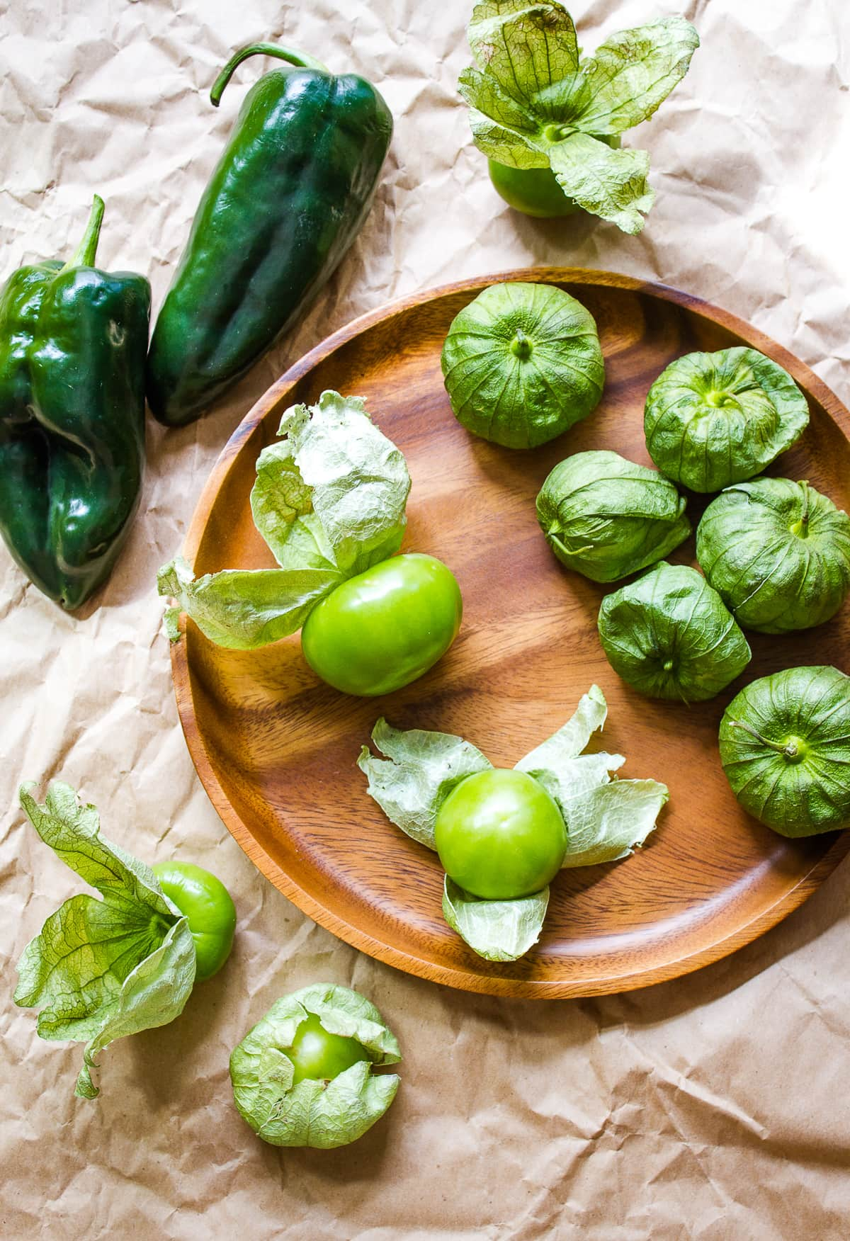 top down view of fresh poblano and tomatillos.