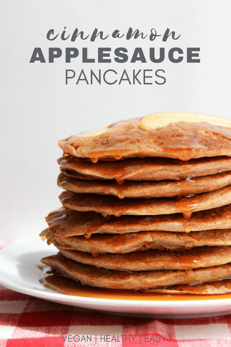 cinnamon applesauce pancakes stacked 8 high with maple syrup on top