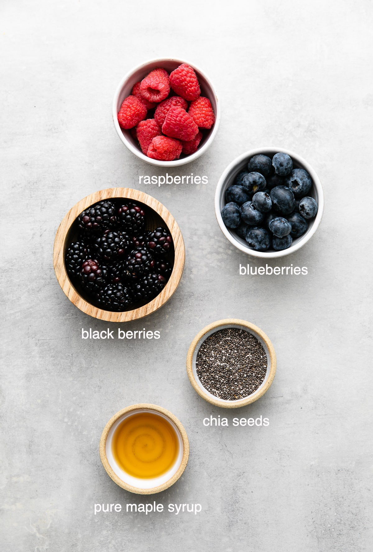 top down view of ingredients used to make healthy chia seed jam recipe with berries.
