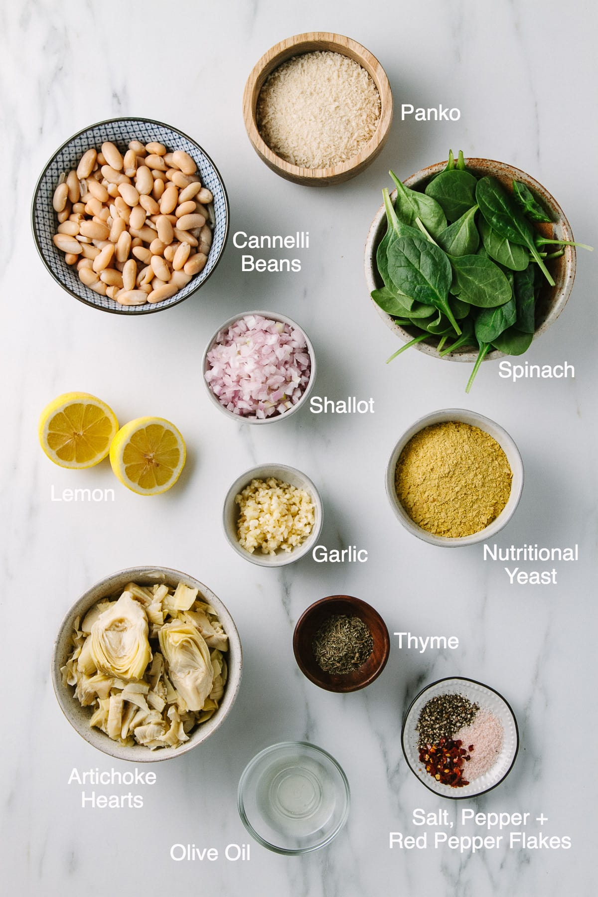 top down view of ingredients needed to make spinach artichoke white bean dip.