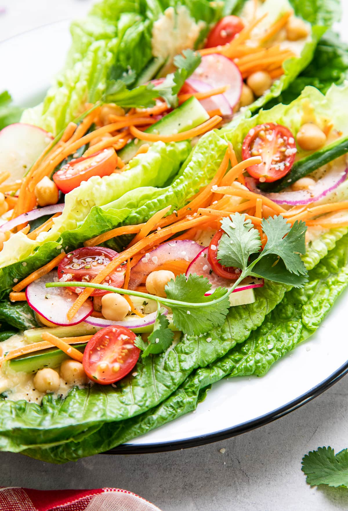 side angle view of light and healthy, fresh vegan lettuce wraps on a plate.