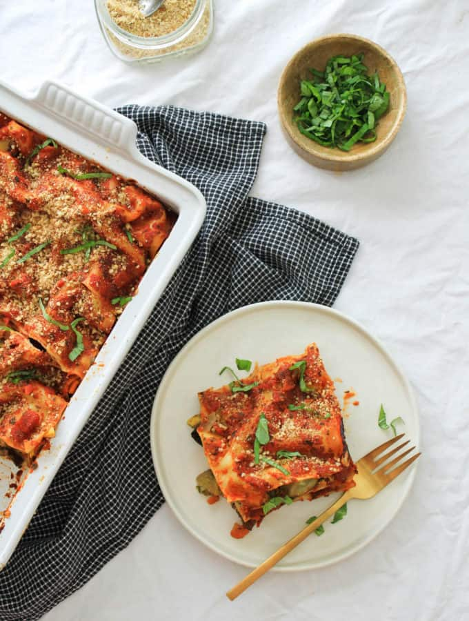 vegan lasagna with cashew ricotta slice on a white plate