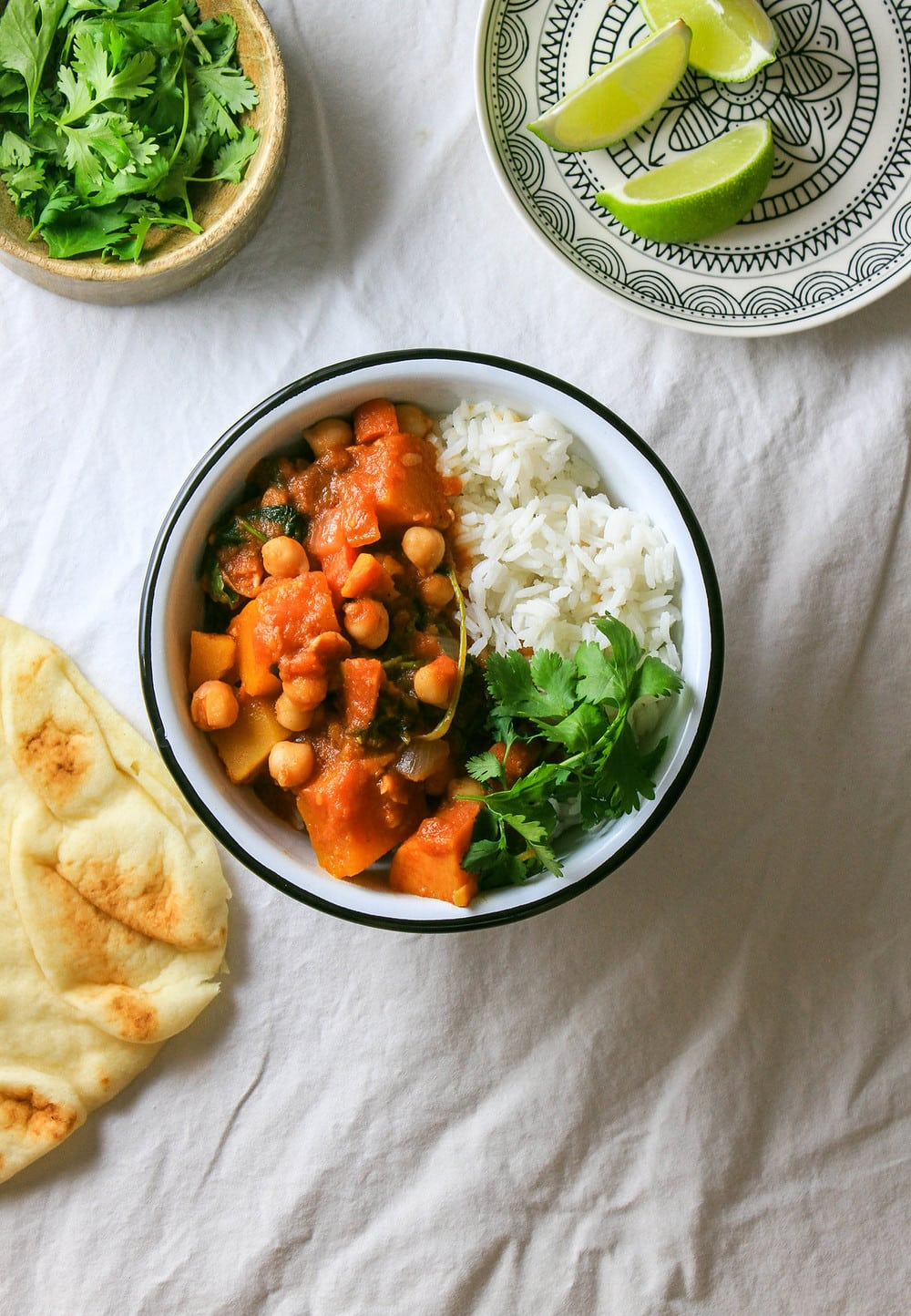 top down view of bowl of moroccan pumpkin chickpea stew with rice