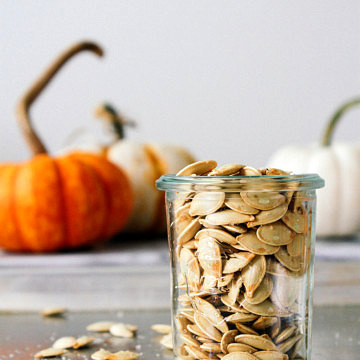 roasted pumpkin seeds in glass jar