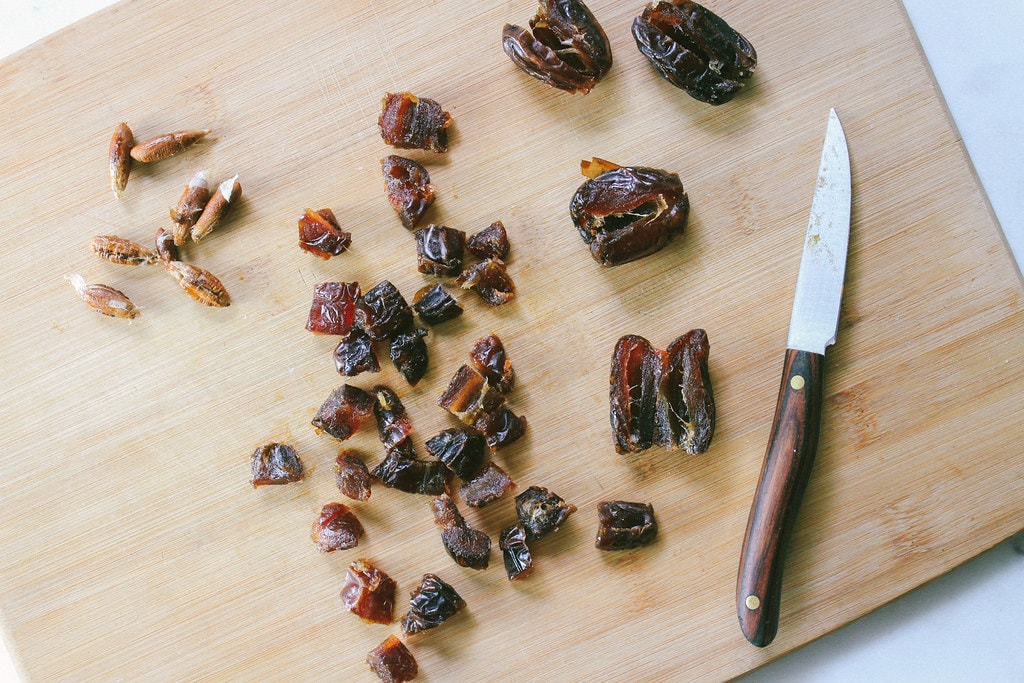 top down view showing the process of removing seeds from dates.