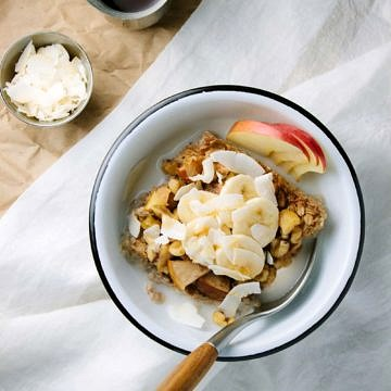baked apple + banana oatmeal with coconut and apple slices