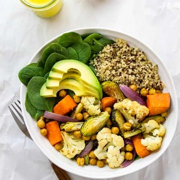 ROASTED CAULIFLOWER & SWEET POTATO NOURISH BOWL + TURMERIC TAHINI DRESSING