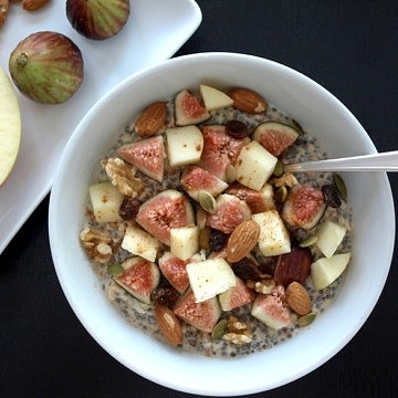 Bircher Muesli with chia seeds, figs and apples in a white bowl