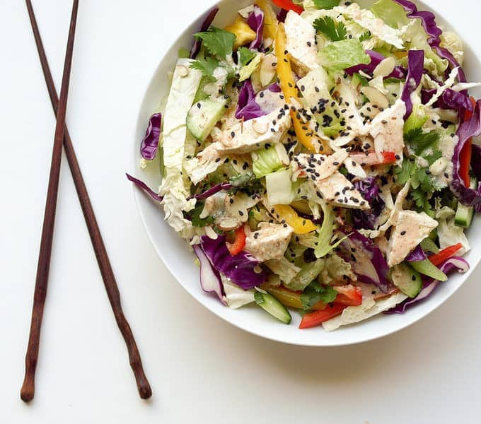 chinese chop salad + peanut dressing in bowl