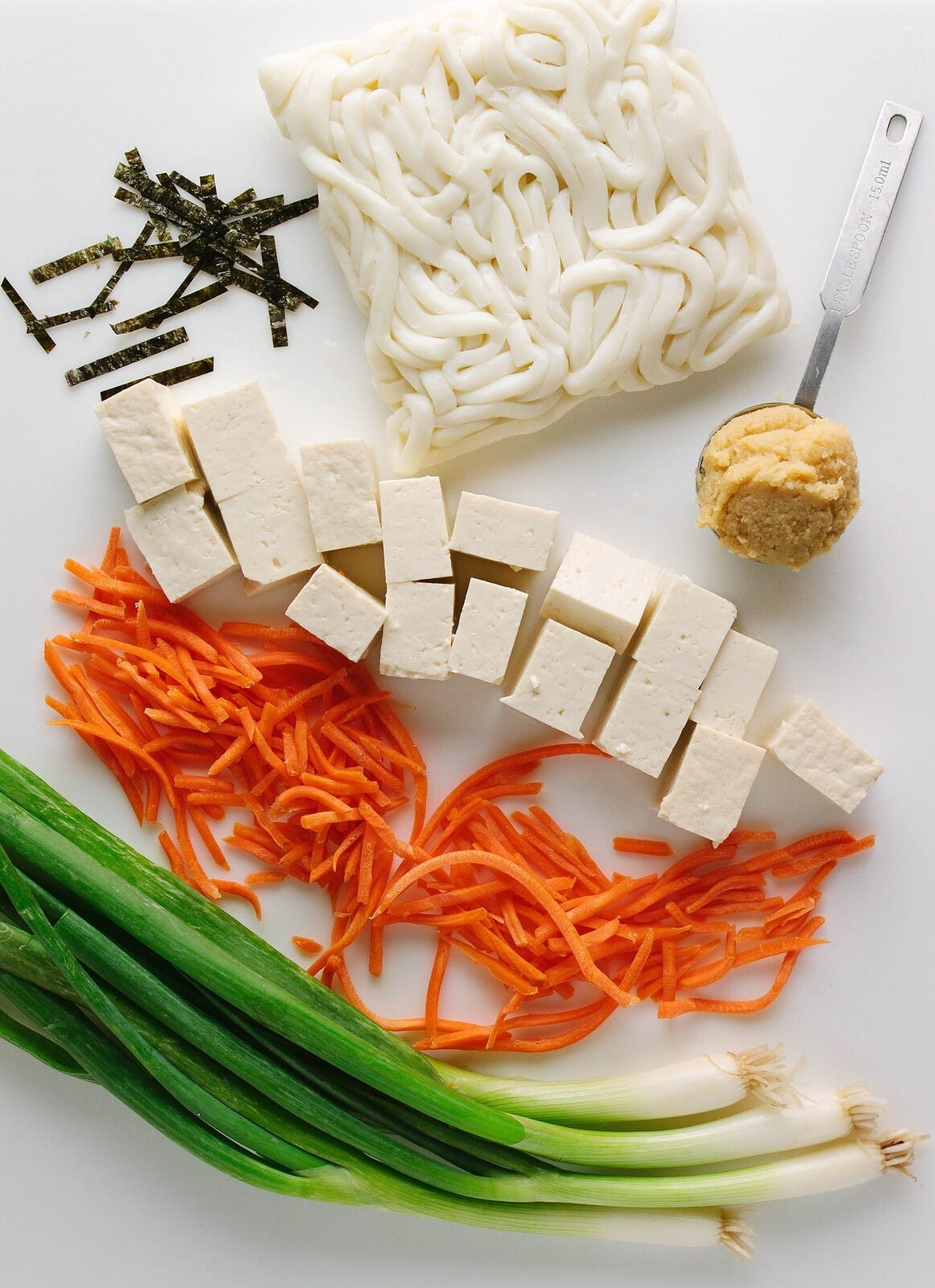 top down view of ingredients used to make healthy vegan miso soup with noodles.
