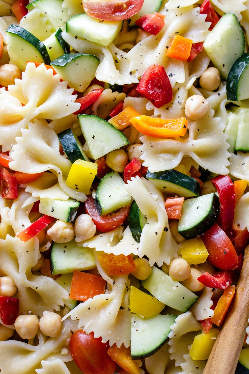 up close view of chickpea vegetable pasta salad.