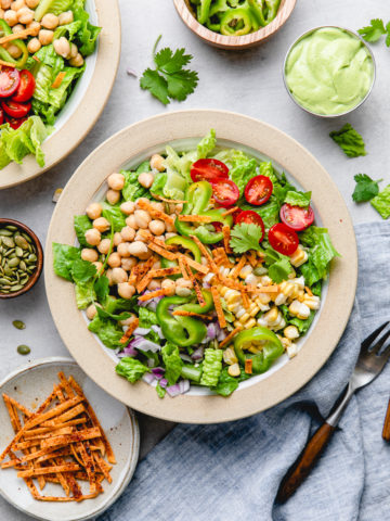 top down view of plated southwest chickpea salad with items surrounding.