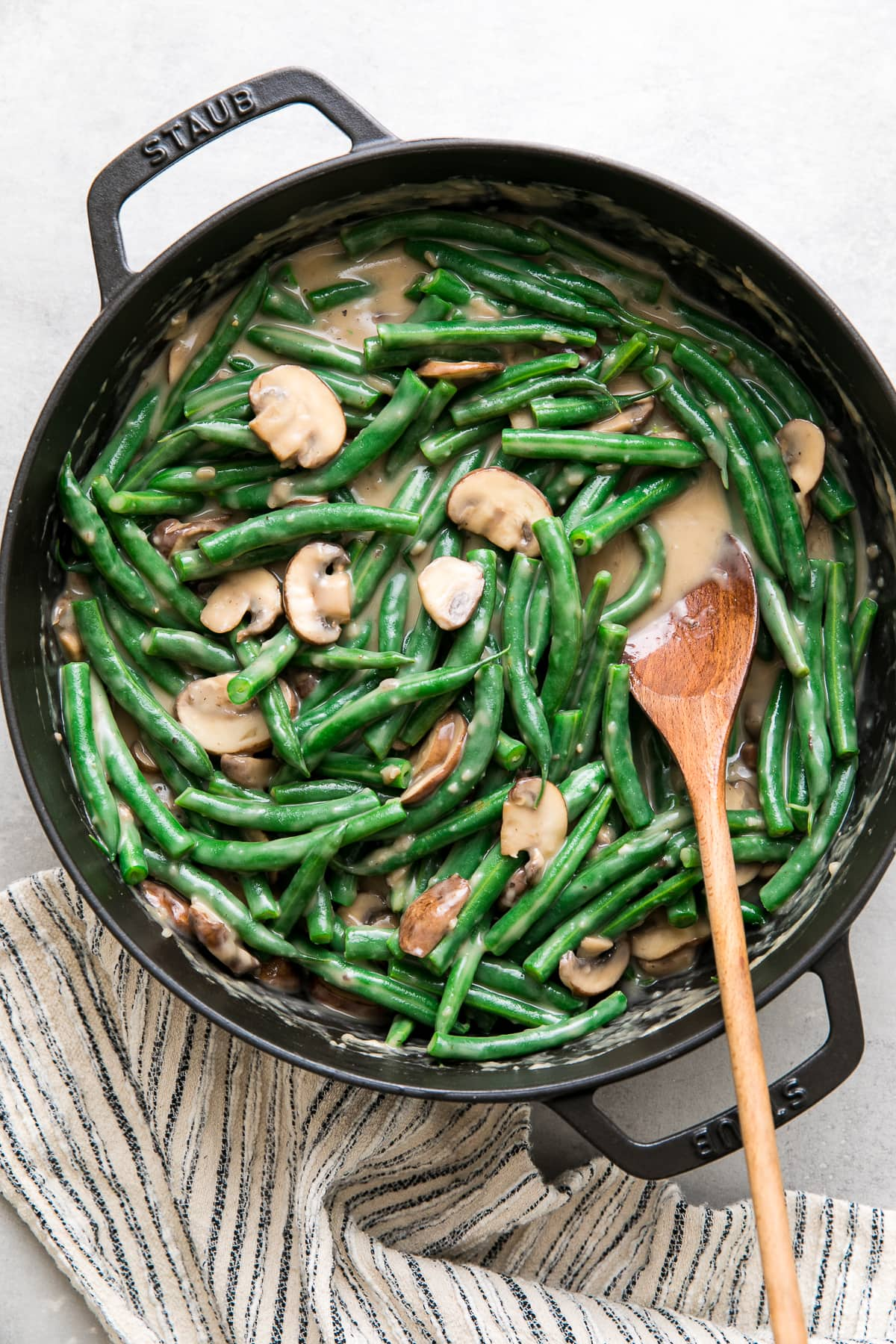 top down view of a pot with freshly made mushroom sauce with green beans mixed in.