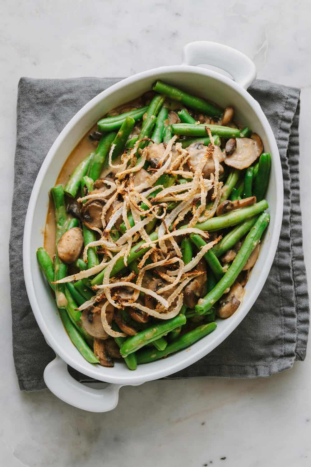 fresh green bean casserole made from scratch in a white serving dish
