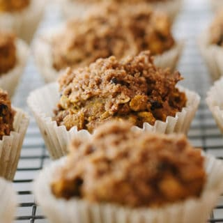 healthy pumpkin oat muffins with crumble topping cooling on a wire rack