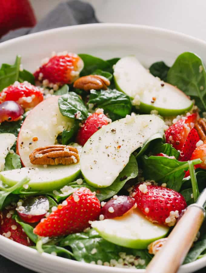 strawberry, apple + quinoa spinach salad with pecans and simple dressing