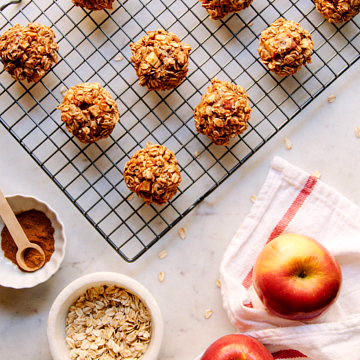a top down view of a wire rack with cinnamon applesauce oatmeal breakfast cookies are cooking