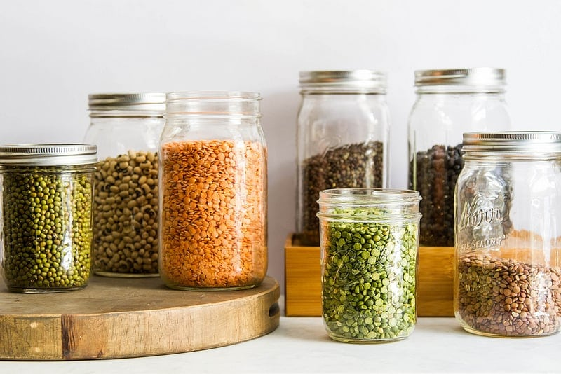 Looking to stock your kitchen with whole food, vegan items? Let this comprehensive guide help you build a healthy, plant-based kitchen pantry!