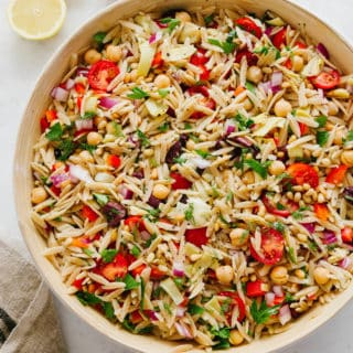 mediterranean orzo salad in large wooden serving bowl