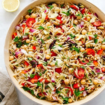 big bowl of mediterranean orzo salad