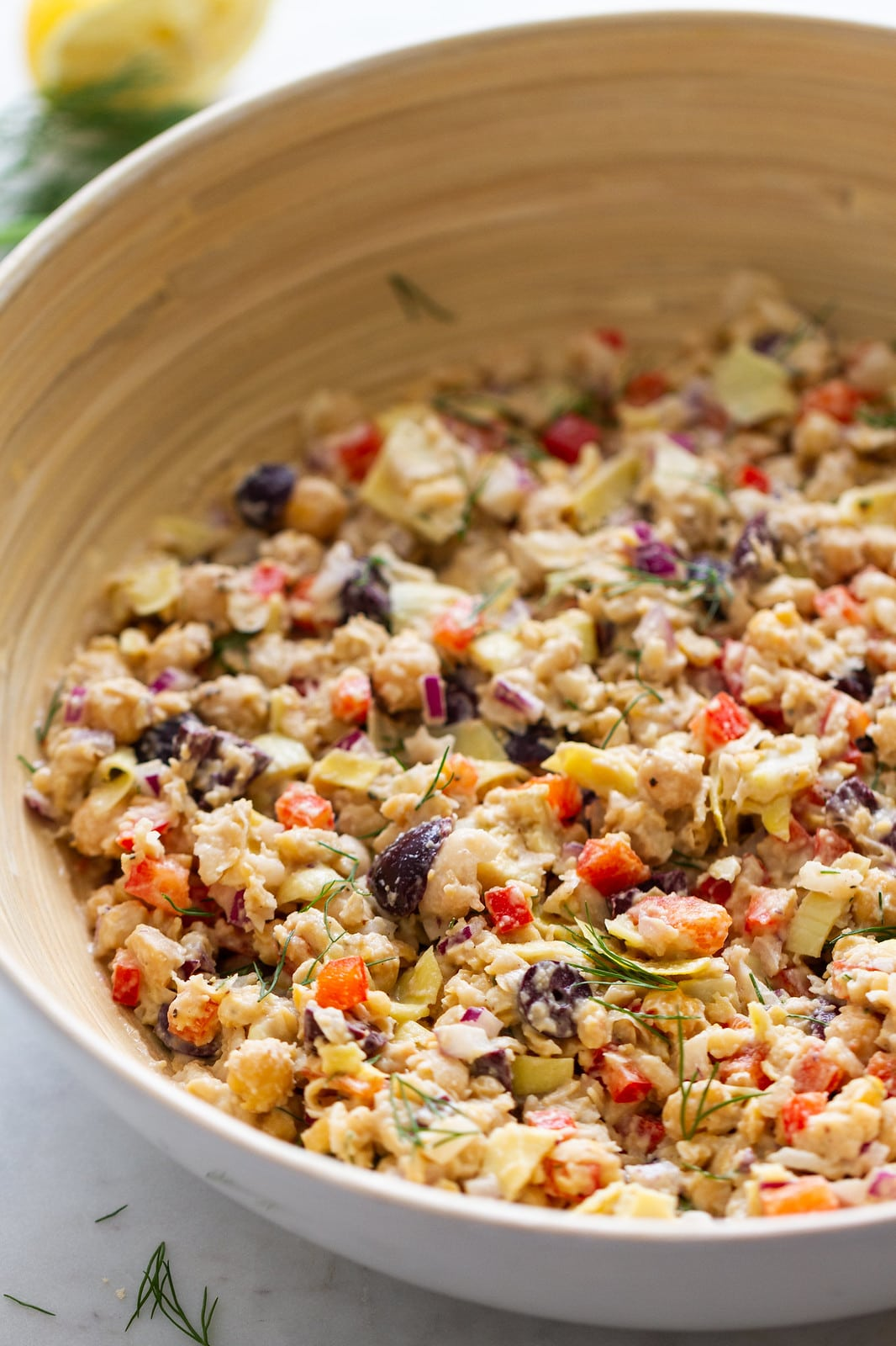 side angle view of a bowl with freshly made mediterranean smashed chickpea salad.