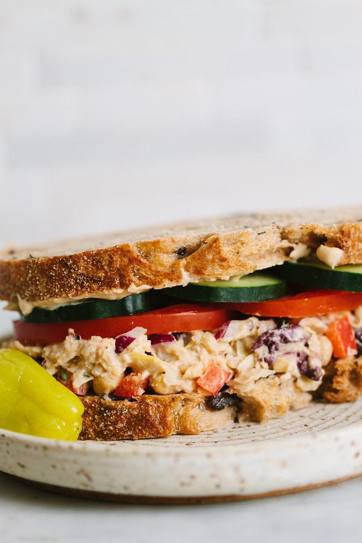 head on shot of smashed mediterranean chickpea salad sandwich.