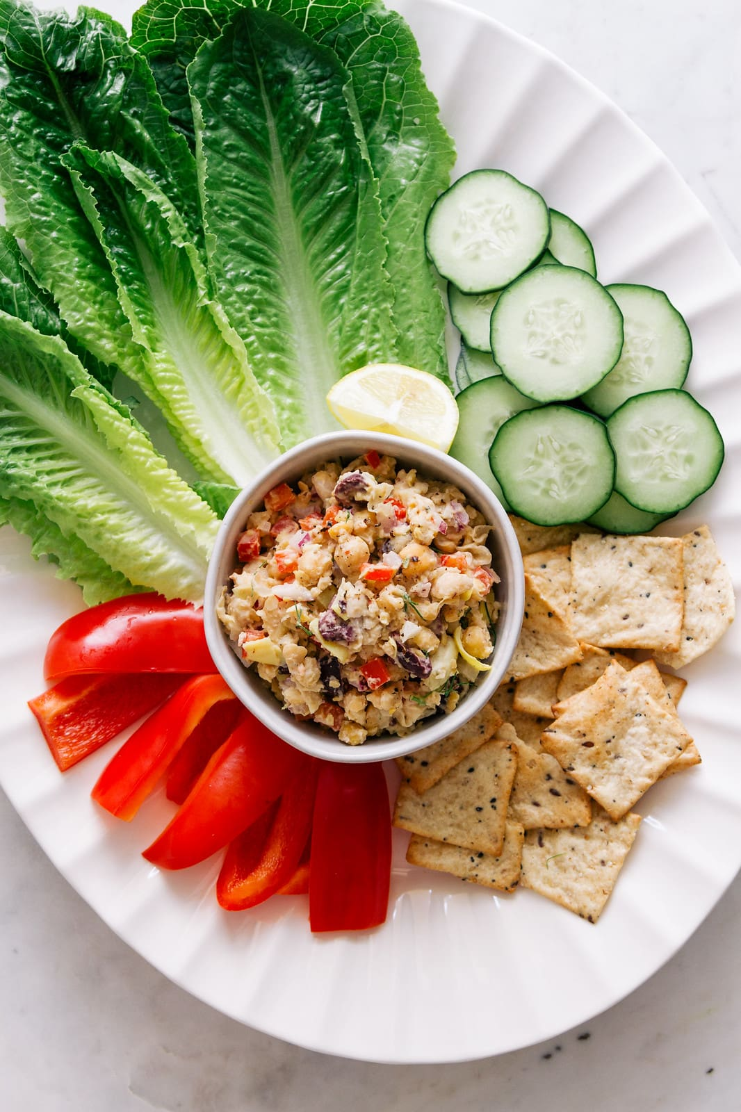 top down view of platter with mediterranean chickpea salad.