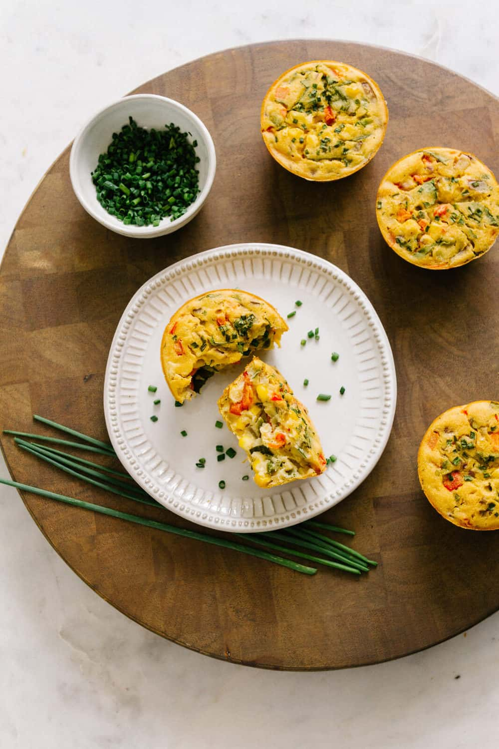 easy vegan mini chickpea flour frittatas on a cream colored plate with chives