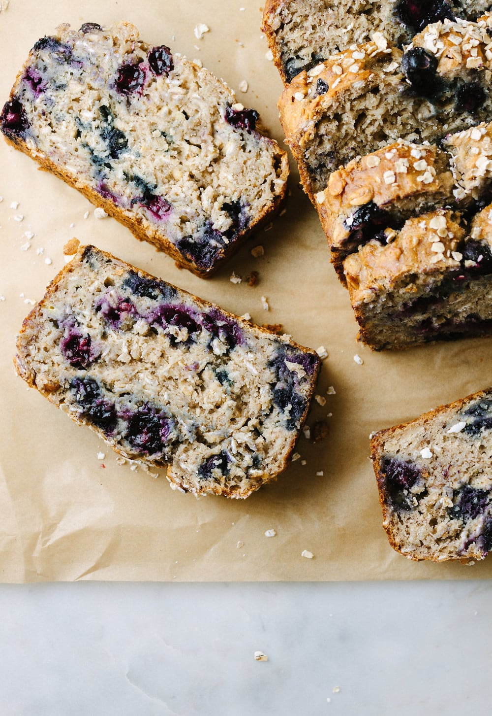 top down view of vegan blueberry banana oat bread sliced