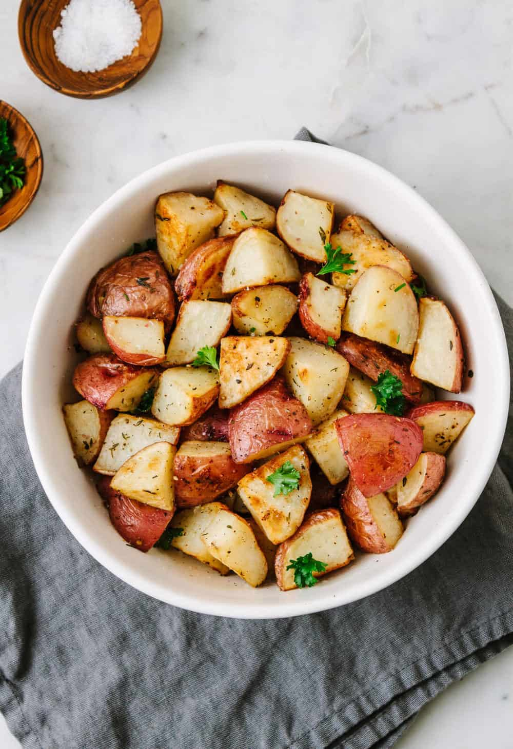 easy crispy roasted red potatoes in a white serving dish