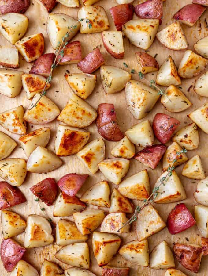 crispy oven roasted red potatoes on a baking sheet