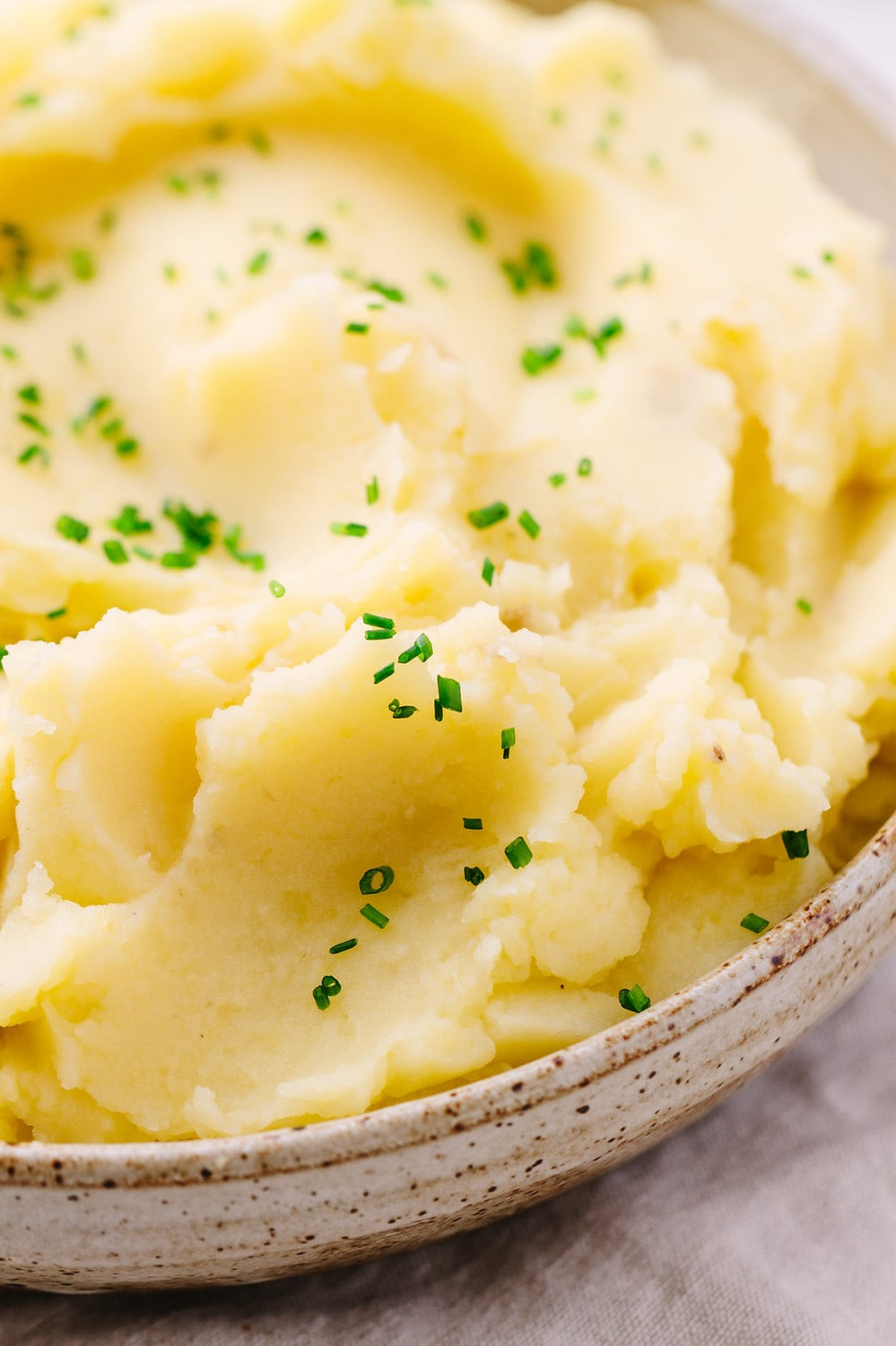 side view of vegan mashed potatoes in a bowl