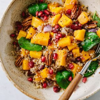 healthy butternut squash quinoa salad in a bowl with fork