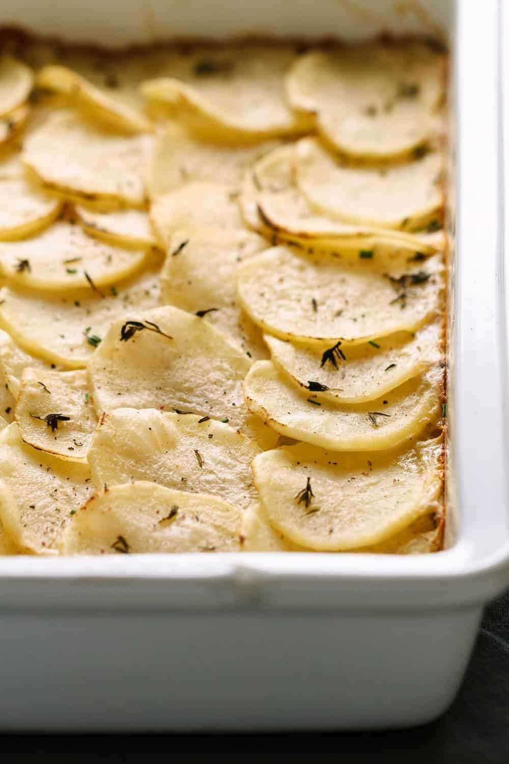 healthy & creamy easy vegan scalloped potatoes in a white baking dish