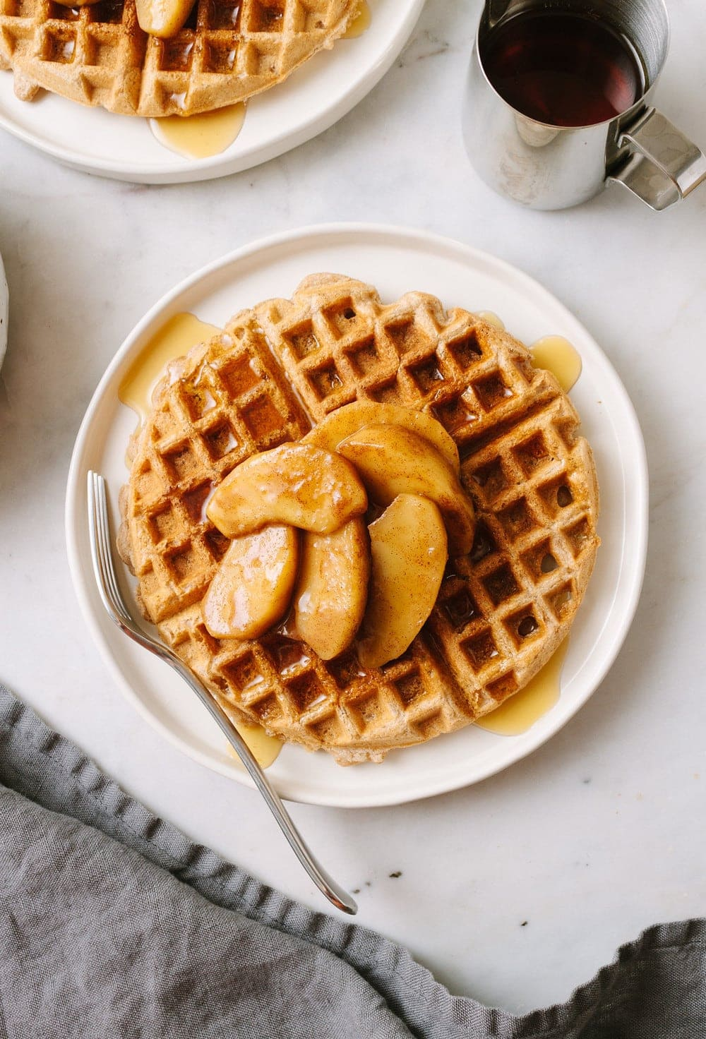 top down view best applesauce waffles on a white plate with fork