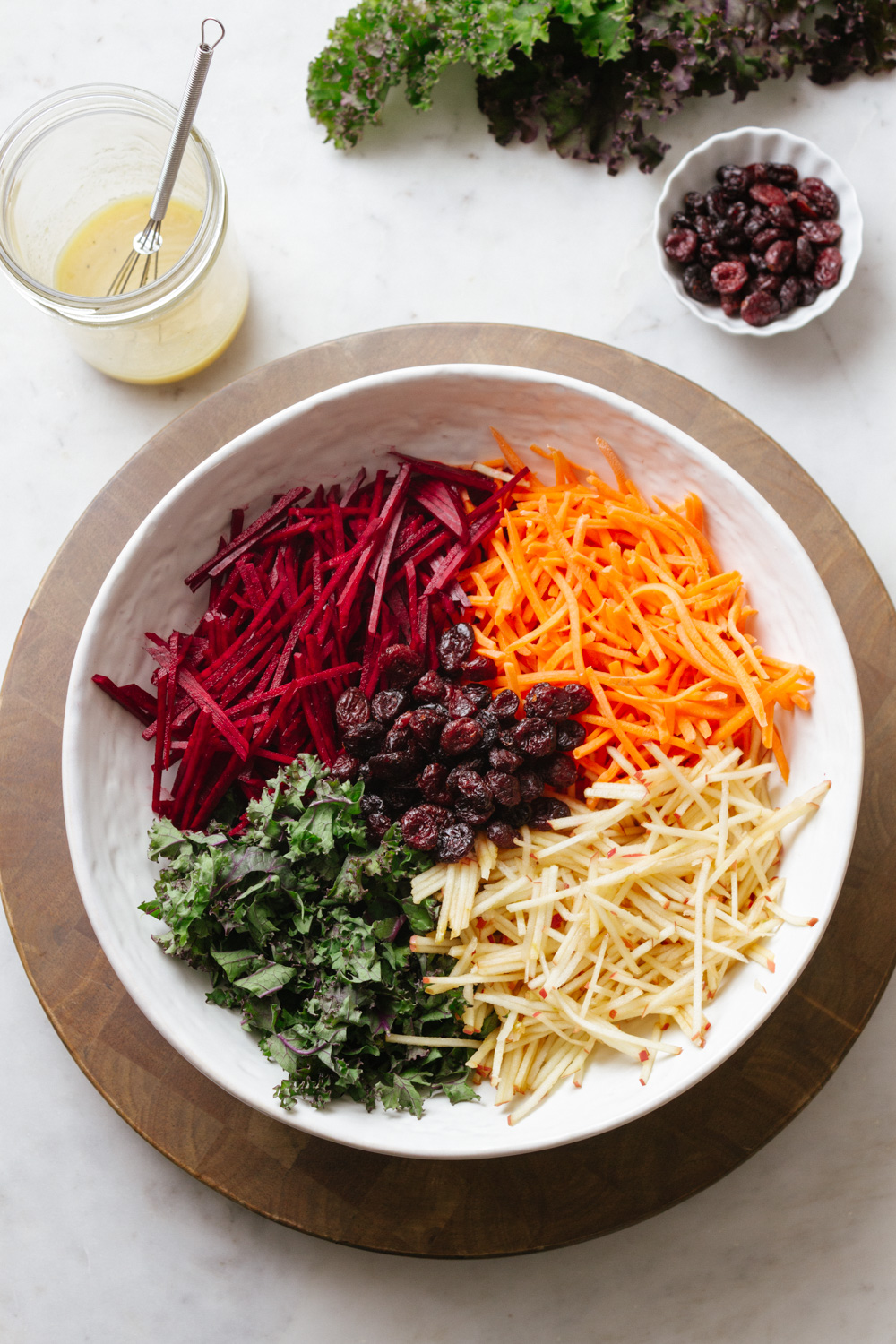 apple beet carrot kale salad in white bowl
