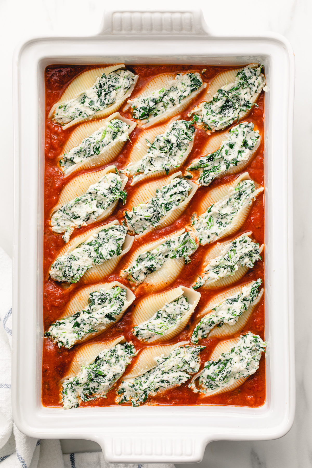 top down view of baking dish with vegan stuffed shells ready for the oven.