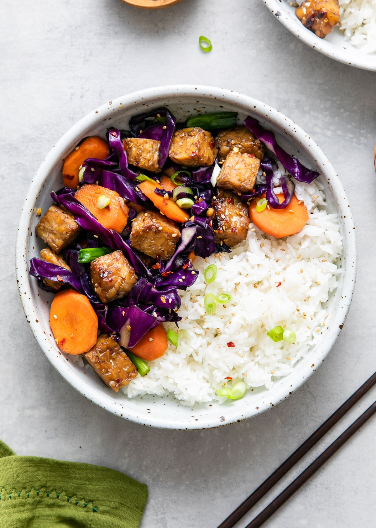 top down view of bowl with serving of maple mirin tempeh stir fry with rice.