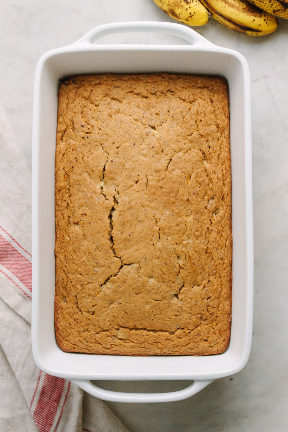 top down view of freshly baked banana bread cooling before frosting.