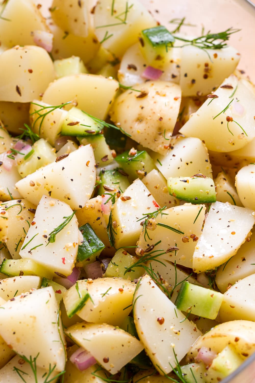 up close, side angle view of healthy german potato salad with dill.