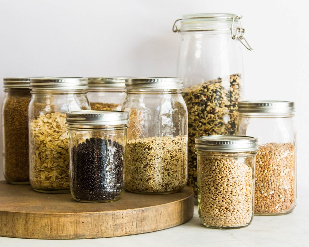 mason jars filled with various types of grains.