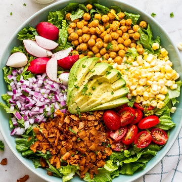 top down view of vegan california cobb salad before adding vegan ranch dressing.