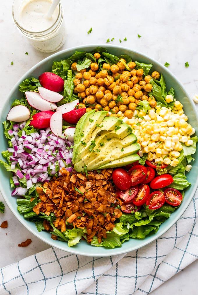 top down view of vegan california cobb salad before adding vegan ranch dressing.