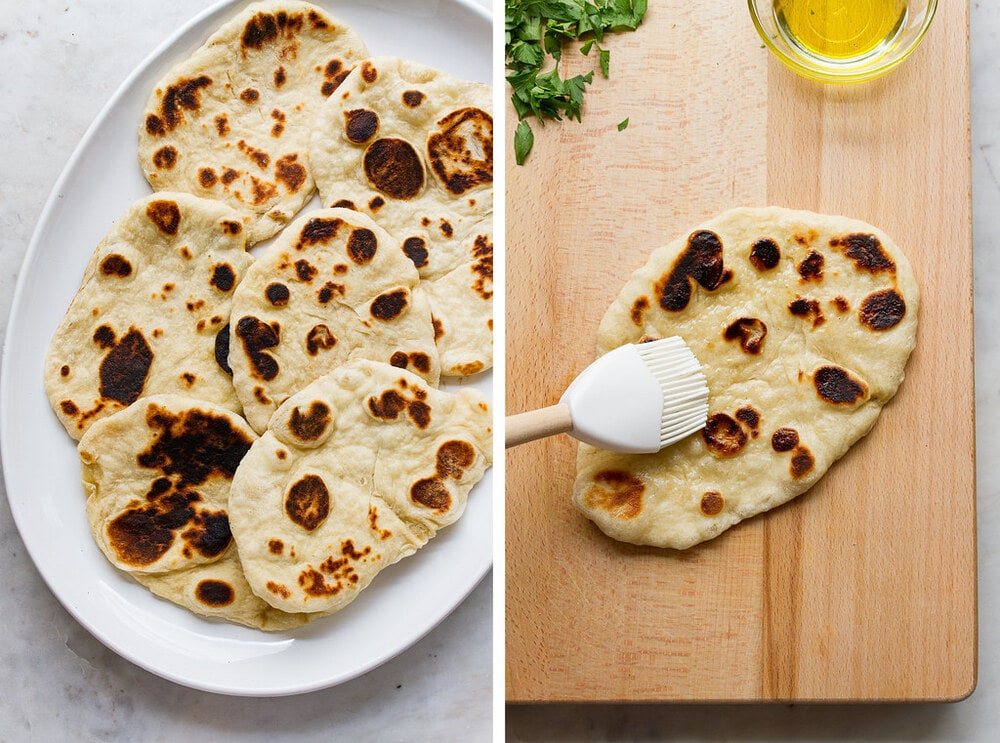 top down view of finished vegan naan bread on a platter and coating with melted vegan butter or oil.