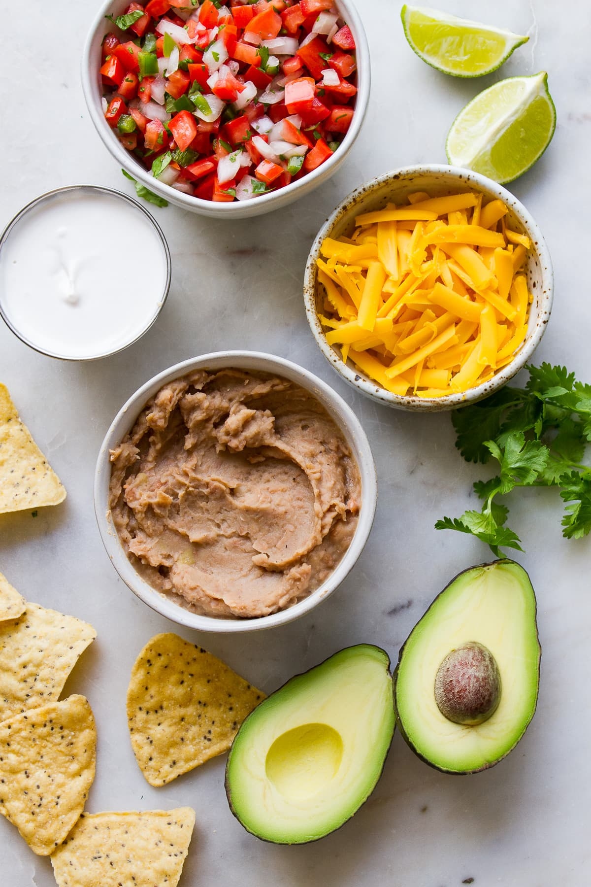 top down view of ingredients to make nacho bowls.