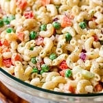 side angle view of vegan macaroni salad in a glass bowl.